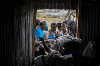 Tigrayans stand in line to receive food donated by local residents at a reception center for the internally displaced in Mekele, in the Tigray region of northern Ethiopia, on Sunday, May 9, 2021. (AP Photo/Ben Curtis)