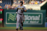 Pittsburgh Pirates shortstop Kevin Newman rounds second base after hitting a home run against the Washington Nationals during the first inning of a baseball game, Monday, June 14, 2021, in Washington. (AP Photo/Carolyn Kaster)