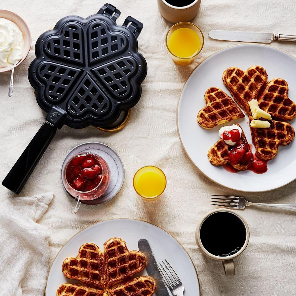 """<p><strong>Nordic Ware</strong></p><p>food52.com</p><p><strong>$58.00</strong></p><p><a href=""""https://go.redirectingat.com?id=74968X1596630&url=https%3A%2F%2Ffood52.com%2Fshop%2Fproducts%2F4486-stovetop-sweetheart-waffle-iron&sref=https%3A%2F%2Fwww.thepioneerwoman.com%2Ffood-cooking%2Fcooking-tips-tutorials%2Fg36344192%2Fbest-waffle-makers%2F"""" rel=""""nofollow noopener"""" target=""""_blank"""" data-ylk=""""slk:Shop Now"""" class=""""link rapid-noclick-resp"""">Shop Now</a></p><p>Cast-iron stovetop waffle makers are incredibly versatile. Cook with this heart-shaped iron at home over the stove or take it outside over a campfire! </p>"""