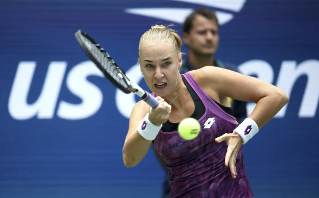 Anna Blinkova, of Russia, returns a shot to Naomi Osaka, of Japan, during the first round of the US Open tennis tournament Tuesday, Aug. 27, 2019, in New York. (AP Photo/Michael Owens)