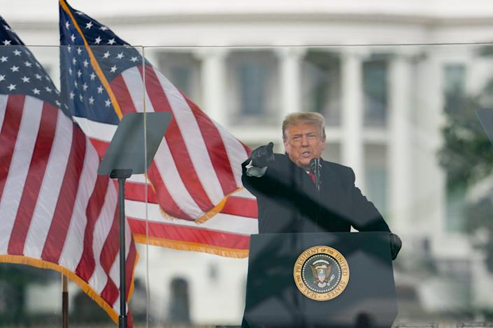 """President Donald Trump encourages protesters to """"walk down to the Capitol"""" where lawmakers were set to confirm Joe Biden as president Jan. 6 before the rally became violent."""