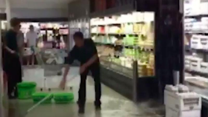 Staff tried to keep their cool as the Melbourne Woolworths began to flood. Source: 7 News