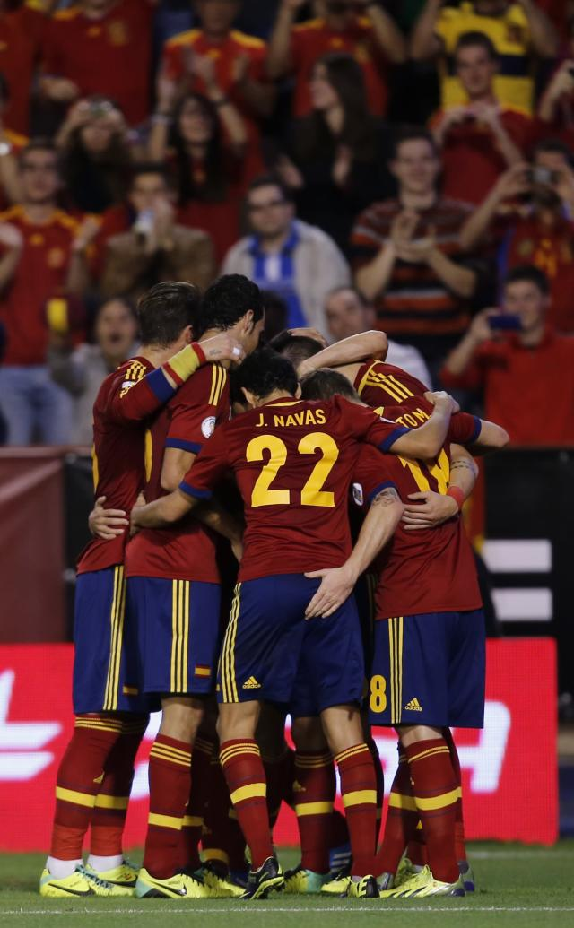 Spain's players celebrate after Alvaro Negredo, not seen, scored during a 2014 World Cup Group I qualifying soccer match between Spain and Georgia at the Carlos Belmonte stadium in Albacete, Spain, Tuesday Oct. 15, 2013. (AP Photo/Fernando Bustamante)