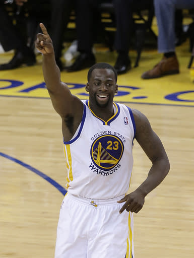 Golden State Warriors small forward Draymond Green (23) gestures after making a basket against the Los Angeles Clippers during the second half of Game 6 of an opening-round NBA basketball playoff series in Oakland, Calif., Thursday, May 1, 2014. The Warriors won 100-99. (AP Photo/Jeff Chiu)