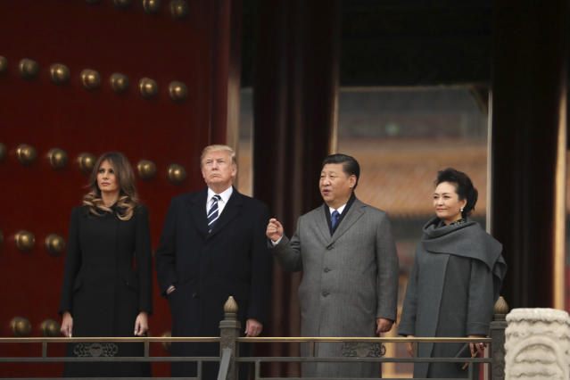 <p>U.S. President Donald Trump, first lady Melania Trump, Chinese President Xi Jinping and his wife Peng Liyuan, right, stand together as they tour the Forbidden City, Wednesday, Nov. 8, 2017, in Beijing, China. Trump is on a five-country trip through Asia traveling to Japan, South Korea, China, Vietnam and the Philippines. (AP Photo/Andrew Harnik) </p>