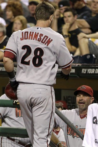 Arizona Diamondbacks' Chris Johnson is welcomed back to the dugout by manager Kirk Gibson after hitting a three-run home run off Pittsburgh Pirates relief pitcher Jason Grilli in the eighth inning of a baseball game in Pittsburgh on Tuesday, Aug. 7, 2012. (AP Photo/Gene J. Puskar)