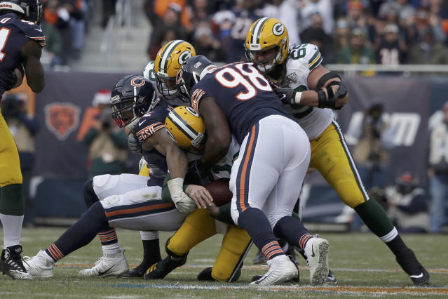 Chicago's Khalil Mack (L) and defensive tackle Bilal Nichols sack Green Bay's Aaron Rodgers in the first half on Sunday. (AP)
