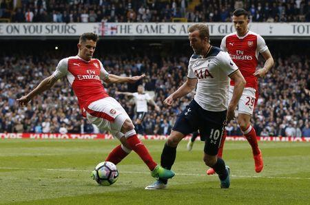 Britain Football Soccer - Tottenham Hotspur v Arsenal - Premier League - White Hart Lane - 30/4/17 Tottenham's Harry Kane is brought down by Arsenal's Gabriel Paulista for a penalty Action Images via Reuters / Paul Childs Livepic