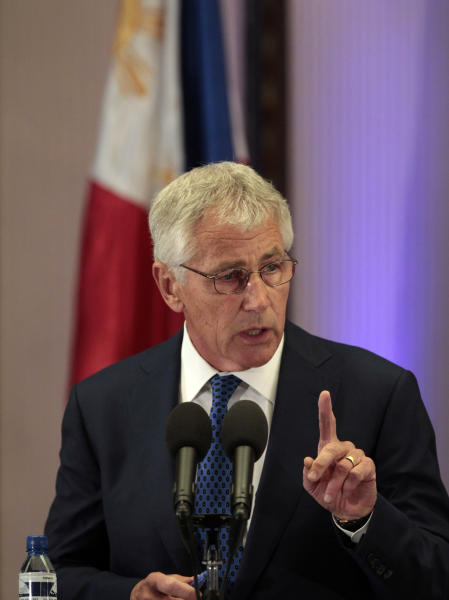 """U.S. Defense Secretary Chuck Hagel gestures as he answers questions from reporters during his visit at the Malacanang Presidential Palace in Manila, Philippines on Friday, Aug. 30, 2013. Hagel said Friday the Obama administration was consulting with allies to """"further develop the facts"""" about last week's alleged chemical weapons attack in Syria, and options for a response. (AP Photo/Aaron Favila)"""