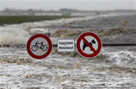 Traffic signs are seen on the North Sea beach near the town of Norddeich