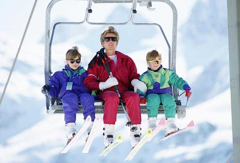 The Princess Of Wales with her two sons, Prince William and Prince Harry on a chairlift during a ski holiday in Lech, Austria. Photo by Tim Graham/Getty Images.