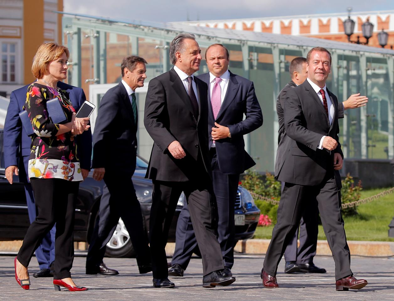 Russian Prime Minister Dmitry Medvedev (R), Sports Minister Vitaly Mutko (C) and Russian Olympic Committee (ROC) chief Alexander Zhukov (3rd L) take part in the awarding of new cars to Russian Olympic medallists returning home from the 2016 Rio Olympics in Moscow's Kremlin, Russia, August 25, 2016. REUTERS/Maxim Shemetov