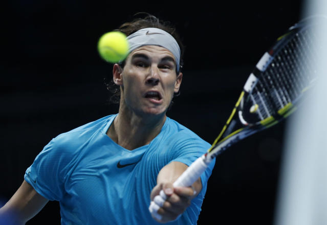 Rafael Nadal of Spain plays a return to David Ferrer of Spain during their ATP World Tour Finals single tennis match at the O2 Arena in London Tuesday, Nov. 5, 2013. (AP Photo/Sang Tan)