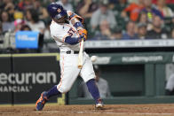Houston Astros' Jose Altuve hits a home run against the Chicago White Sox during the sixth inning of a baseball game Thursday, June 17, 2021, in Houston. (AP Photo/David J. Phillip)