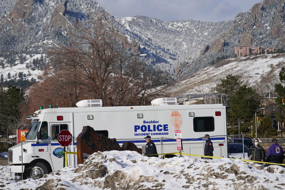 Police head into the parking lot outside a King Soopers grocery store where a mass shooting took place Tuesday, March 23, 2021, in Boulder, Colo. (AP Photo/David Zalubowski)