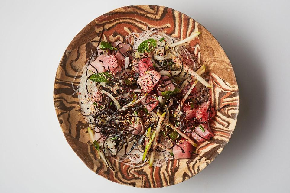 """The green pear adds crunch and sweet-tart notes to this raw yellowtail preparation. A Granny Smith apple, Asian pear, or pineapple would do the same. <a href=""""https://www.epicurious.com/recipes/food/views/yellowtail-poke-with-glass-noodles-and-pear?mbid=synd_yahoo_rss"""" rel=""""nofollow noopener"""" target=""""_blank"""" data-ylk=""""slk:See recipe."""" class=""""link rapid-noclick-resp"""">See recipe.</a>"""