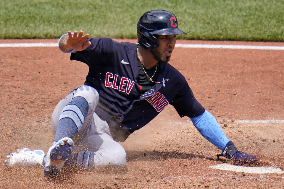 Cleveland Indians' Eddie Rosario scores from second on a single by Josh Naylor off Pittsburgh Pirates relief pitcher Chasen Shreve during the seventh inning of a baseball game in Pittsburgh, Sunday, June 20, 2021. (AP Photo/Gene J. Puskar)