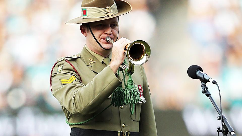 The Last Post, pictured here being played at an AFL match on Anzac Day.