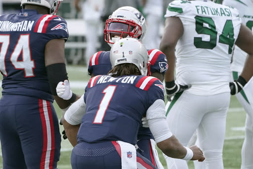 New England Patriots quarterback Cam Newton, front, and running back James White, rear, celebrate after Newton threw a touchdown pass to White in the first half of an NFL football game against the New York Jets, Sunday, Jan. 3, 2021, in Foxborough, Mass. (AP Photo/Elise Amendola)