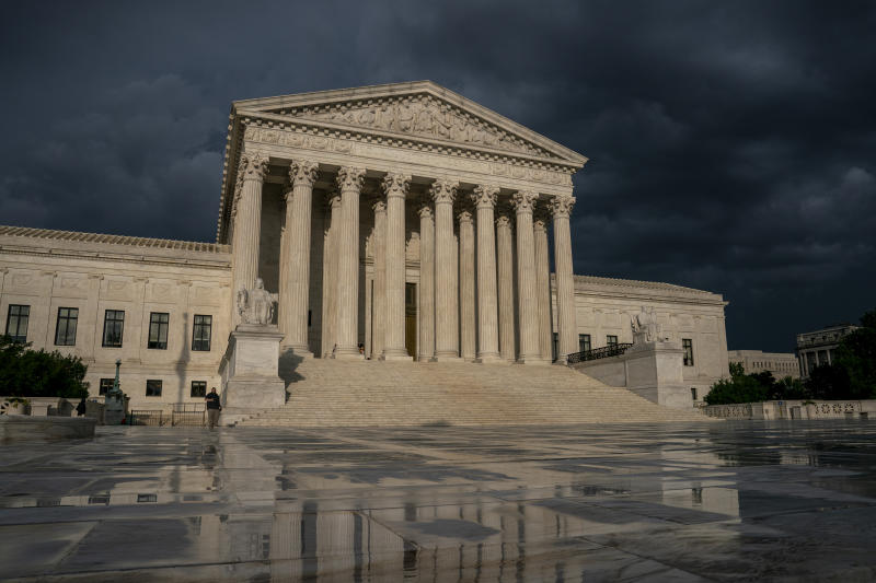 FILE - In this June 20, 2019 file photo, The Supreme Court is seen under stormy skies in Washington. The Supreme Court says it will hear President Donald Trump's pleas to keep his tax, bank and financial records private. (AP Photo/J. Scott Applewhite)