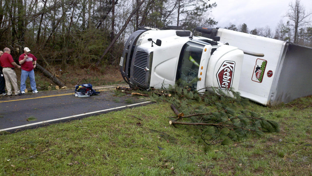 A semitrailer lies flipped near Sparkman High School on Jeff Road after a reported tornado came through Harvest, Ala., Friday, March 2, 2012. (AP Photo/The Huntsville Times, Eric Schultz)