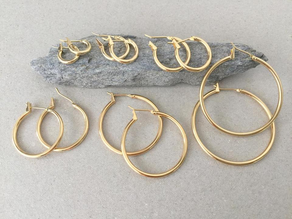 <p>Aries don't like to be bored, and with this <span>Gold Hoop Earring Set</span> ($97), they won't be.</p>