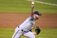 Milwaukee Brewers starting pitcher Adrian Houser throws during the first inning of a baseball game against the Miami Marlins, Saturday, May 8, 2021, in Miami. (AP Photo/Lynne Sladky)