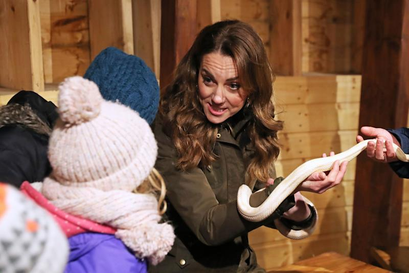 Britain's Catherine, Duchess of Cambridge reacts as she holds a snake during her visit to Ark Open Farm near Belfast on February 12, 2020, as part of her tour of the UK to promote her landmark survey on the early years, '5 Big Questions on the Under-Fives'. (Photo by Liam McBurney / POOL / AFP) (Photo by LIAM MCBURNEY/POOL/AFP via Getty Images)