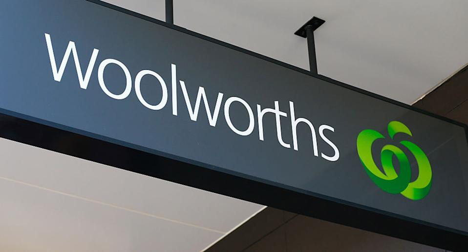 Signage for Woolworths is displayed at one of the company's supermarkets in Sydney.