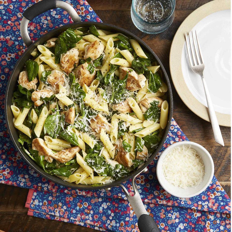 """<p>This one-pan pasta that combines lean chicken breast and sautéed spinach for a one-bowl meal is garlicky, lemony and best served with a little Parm on top. I call it """"Mom's Skillet Pasta"""" and she called it """"Devon's Favorite Pasta."""" Either way it's a quick and easy weeknight dinner we created together and scribbled on a little recipe card more than a decade ago, and it remains in my weekly dinner rotation to this day. It's a simple dinner the whole family will love.</p>"""
