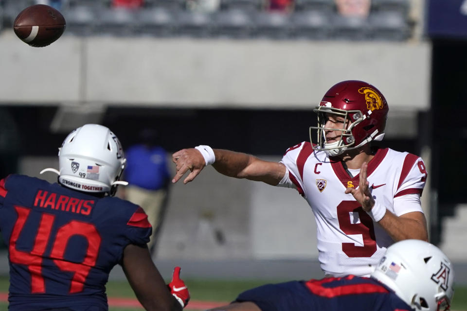 Southern California quarterback Kedon Slovis (9) throws over Arizona linebacker Jalen Harris (49) in the first half during an NCAA college football game, Saturday, Nov. 14, 2020, in Tucson, Ariz. (AP Photo/Rick Scuteri)