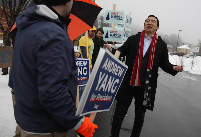 Andrew Yang greets supporters at a polling station in Keene, N.H., on Feb. 11. (Photo by Justin Sullivan/Getty Images)