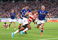 """It's a truism that international tournaments are better when the hosts do well. Japan got off to a flying start by beating Russia 30 - 10. Here photographer Cameron Spencer (Getty Images) captures Kotaro Matsushima of Japan scoring his team's second try. Cameron explains: """"He had serious pace and I swapped to my 70-200mm f/2.8L for this frame thinking he would score in the corner."""""""