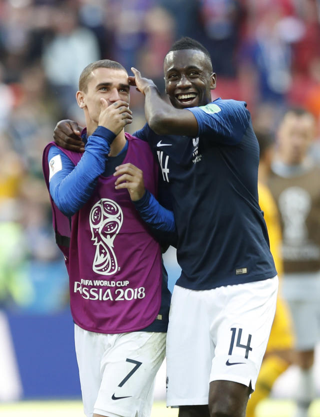 <p>France's Antoine Griezmann, left, speaks to teammate France's Blaise Matuidi after the end of the group C match </p>