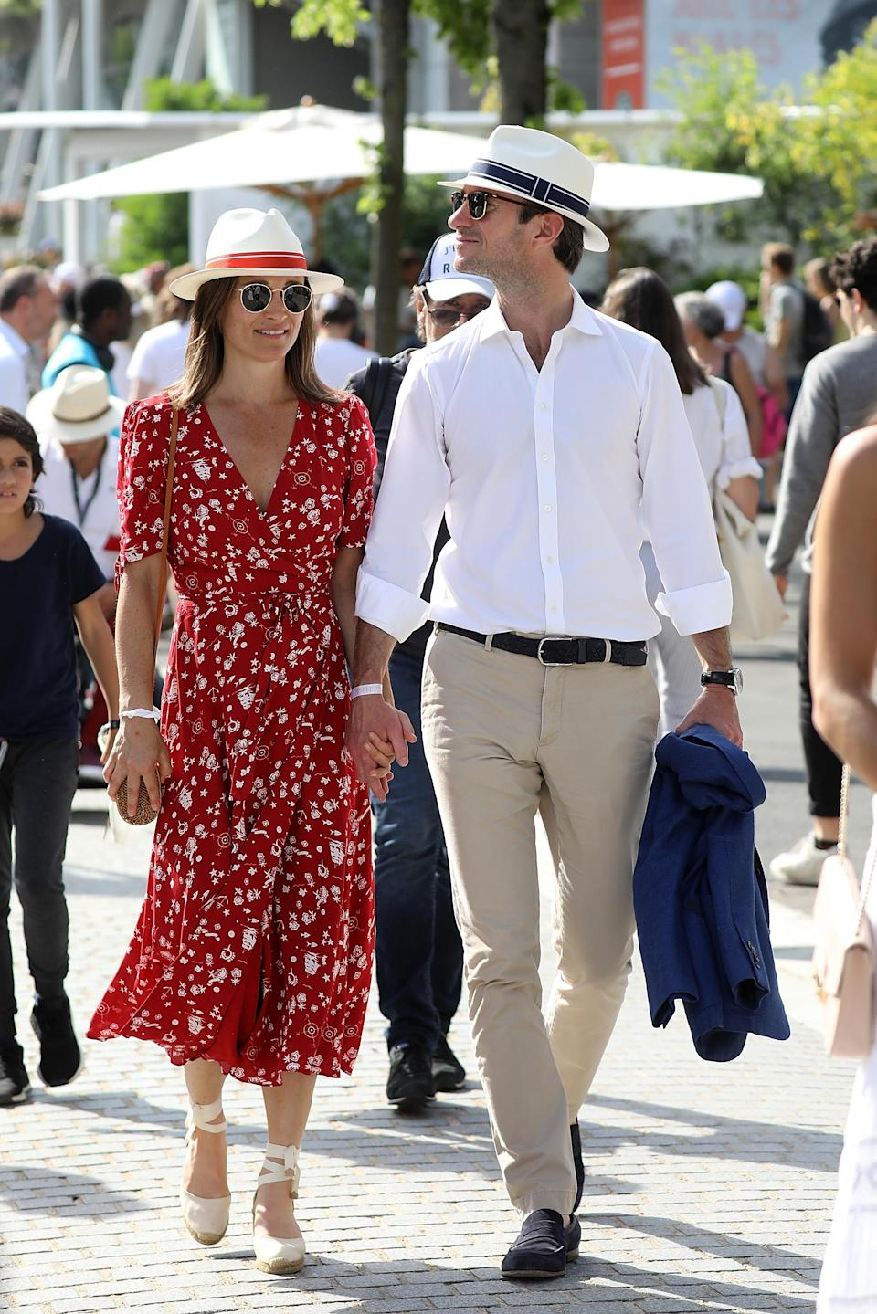 Pippa Middleton and James Matthews wear matching Fedora hats to the French Open. [Photo: Getty]