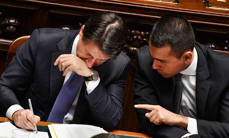 Italy's Foreign Minister Luigi Di Maio (R) speaks to Italy's Prime Minister Giuseppe Conte on September 9, 2019 during the new government confidence vote at the lower house of parliament in Rome. (Photo by Andreas SOLARO / AFP) (Photo credit should read ANDREAS SOLARO/AFP/Getty Images)