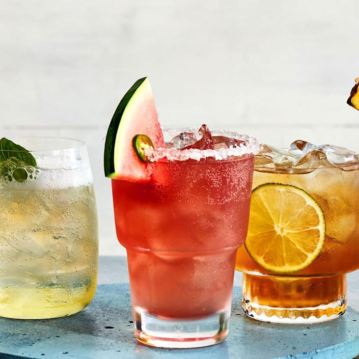 """<p><strong>Recipe: <a href=""""https://www.southernliving.com/recipes/spicy-watermelon-refresher"""" rel=""""nofollow noopener"""" target=""""_blank"""" data-ylk=""""slk:Spicy Watermelon Refresher"""" class=""""link rapid-noclick-resp"""">Spicy Watermelon Refresher</a></strong></p> <p>A serrano chile adds just the right amount of spice and seltzer water adds a fizzy texture to this watermelon cocktail. </p>"""