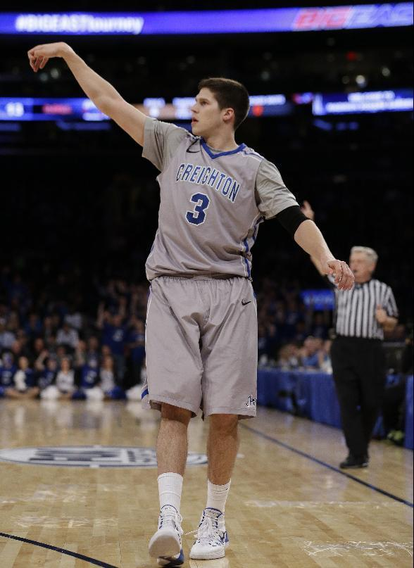 Creighton's Doug McDermott (3) follows through on a 3-point basket during the first half of an NCAA college basketball game against DePaul in the quarterfinals of the Big East Conference tournament on Thursday, March 13, 2014, at Madison Square Garden in New York. (AP Photo/Frank Franklin II)
