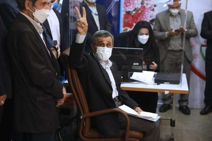 Former President Mahmoud Ahmadinejad flashes a victory sign while registering his name as a candidate for the June 18 presidential elections at the elections headquarters of the Interior Ministry in Tehran, Iran, Wednesday, May 12, 2021. The country's former firebrand president will run again for office in upcoming elections in June. The Holocaust-denying Ahmadinejad has previously been banned from running for the presidency by Supreme Leader Ayatollah Ali Khamenei in 2017, although then, he registered anyway. (AP Photo/Vahid Salemi)