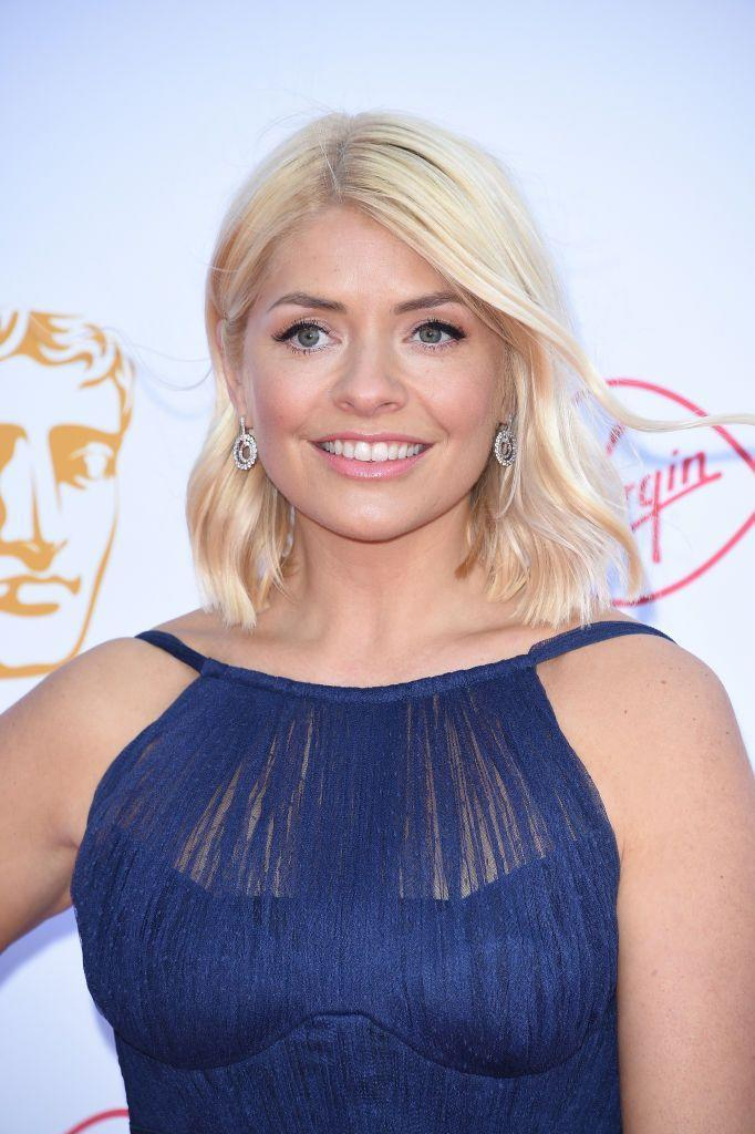 """<p>It's no secret that we're a fan of Marks & Spencer here at Red Online, and nor is it that <a href=""""https://www.redonline.co.uk/fashion/a34614828/holly-willoughbys-marks-and-spencer-coat/"""" rel=""""nofollow noopener"""" target=""""_blank"""" data-ylk=""""slk:Holly Willoughby"""" class=""""link rapid-noclick-resp"""">Holly Willoughby</a> is one, too. The This Morning host — who has worked on several collaborations with the brand — can often be spotted rocking M&S pieces on the sofa, and via her Instagram. Which is why we're certain that the star will be just as excited about the M&S 30% off womenswear sale as we are — especially as two of her favourite dresses are included.</p><p>We've rounded up a couple of Holly's top picks, as well as some of our own, to curate a top 10 of must-have buys in the sale. These pieces should see you through winter and beyond, and are sure to become key pieces in your wardrobe. </p>"""