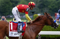 Jockey Mike Smith, reacts after crossing the finish line on Justify to win the 150th running of the Belmont Stakes horse race and the Triple Crown, Saturday, June 9, 2018, in Elmont, N.Y. (AP Photo/Peter Morgan)