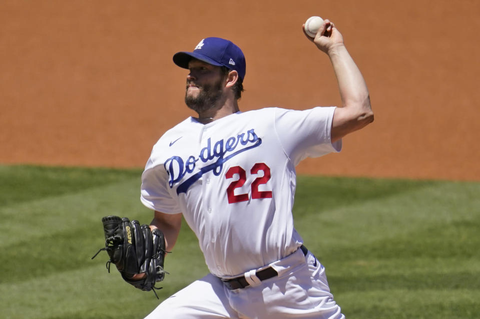 Los Angeles Dodgers starting pitcher Clayton Kershaw throws to the Cincinnati Reds during the first inning of a baseball game Wednesday, April 28, 2021, in Los Angeles. (AP Photo/Marcio Jose Sanchez)