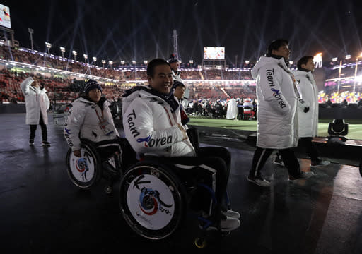 South Korean athletes arrive at the closing ceremony of the 2018 Winter Paralympics in Pyeongchang, South Korea, Sunday, March 18, 2018. (AP Photo/Lee Jin-man)