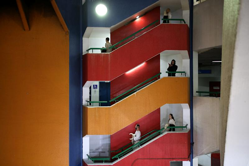 "Actors from the Mystorin Theatre Ensemble, and a passerby, walk down the stairs during the group's show ""Seven,"" at the Central Bus Station on Dec. 27, 2018. (Photo: Corinna Kern/Reuters)"