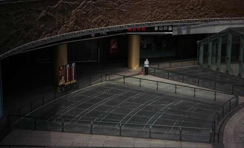 A cleaner at the empty Tianfu Square Metro Station in Chengdu, China. Yuyang Liu © 2020 The New York Times