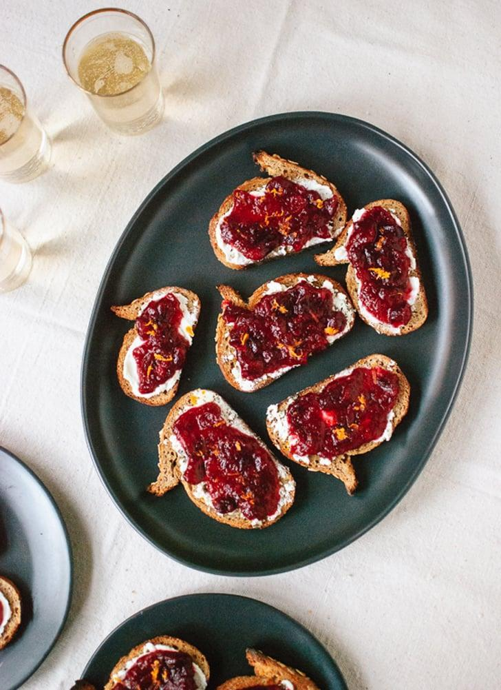 """<p>Easy, simple, and bursting with flavor, these crostini will make your mouth water. The cranberry-orange sauce sits atop a whole-grain crostini that's coated in goat cheese, meaning these will leave you wanting more after just one bite.</p> <p><strong>Get the recipe</strong>: <a href=""""http://cookieandkate.com/2013/cranberry-crostini/"""" class=""""link rapid-noclick-resp"""" rel=""""nofollow noopener"""" target=""""_blank"""" data-ylk=""""slk:cranberry crostini"""">cranberry crostini</a> </p>"""