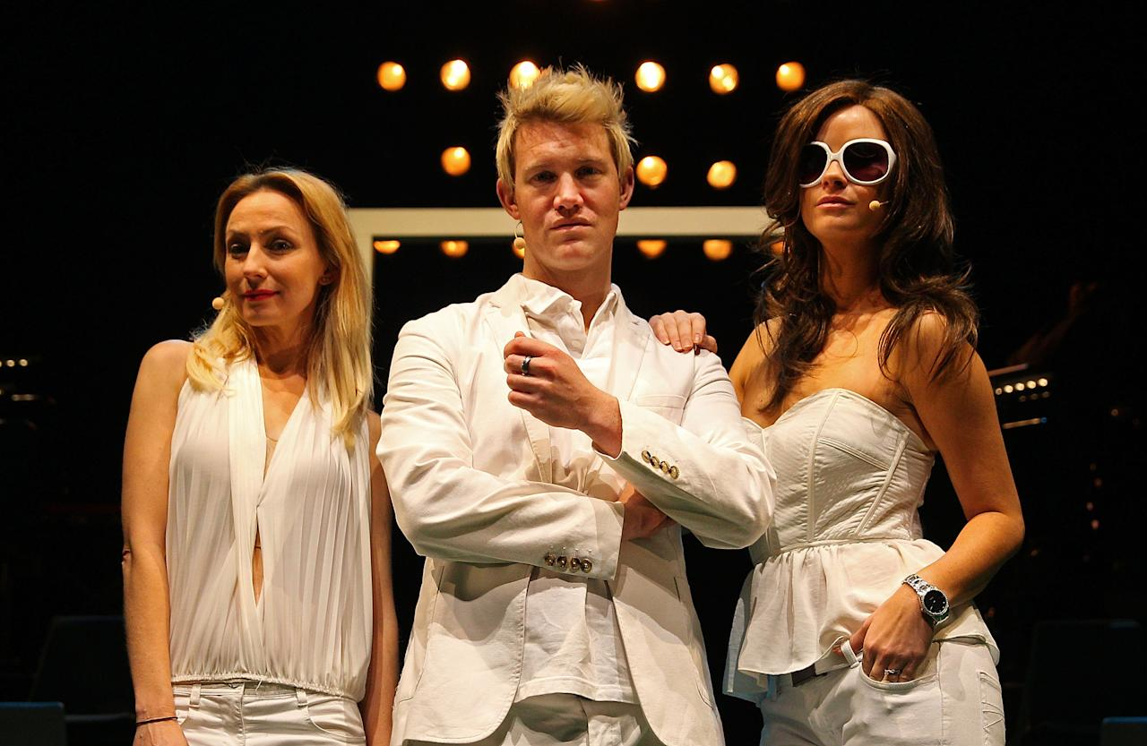 """MELBOURNE, AUSTRALIA - JUNE 20:  (L to R) Lisa McCune, who plays Simone Warne, Eddie Perfect who plays Shane Warne and Christie Whelan Brown who plays Elizabeth Hurley pose during a """"Shane Warne The Musical' media call at the Arts Centre Melbourne on June 20, 2013 in Melbourne, Australia. Shane Warne The Musical is a musical comedy based on the life of Australian cricketer Shane Warne.  (Photo by Scott Barbour/Getty Images)"""