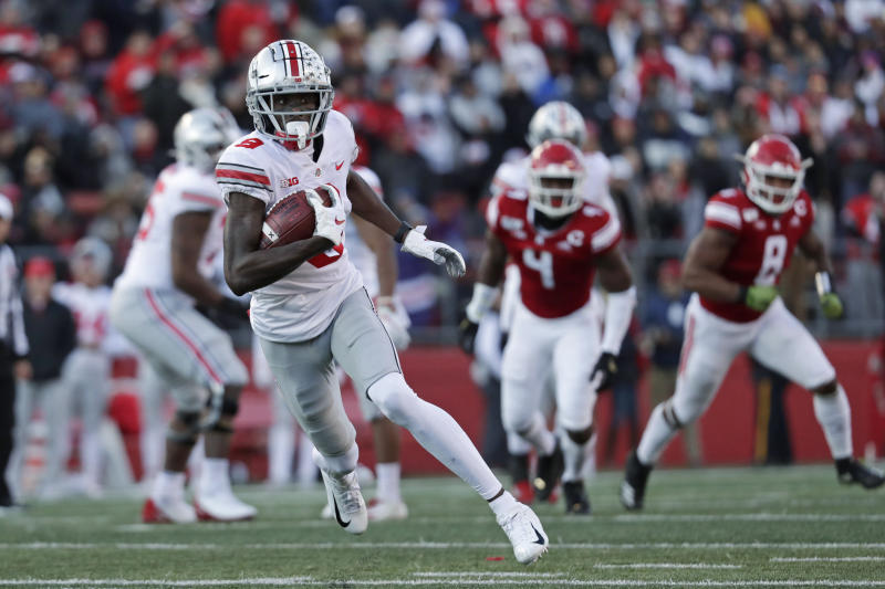 Ohio State wide receiver Binjimen Victor (9) rushes against Rutgers during the first half of an NCAA college football game Saturday, Nov. 16, 2019, in Piscataway, N.J. Ohio State won 56-21. (AP Photo/Adam Hunger)