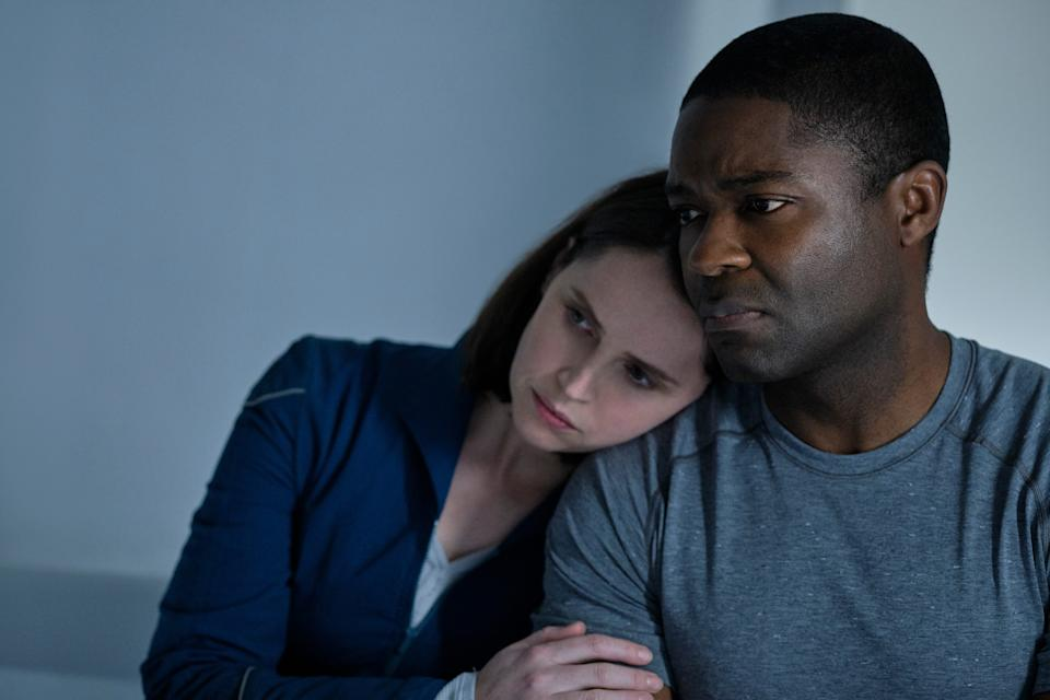 """Astronauts Sully (Felicity Jones) and Commander Tom Adewole (David Oyelowo) learn of Earth's cataclysmic fate while returning home in """"The Midnight Sky."""""""