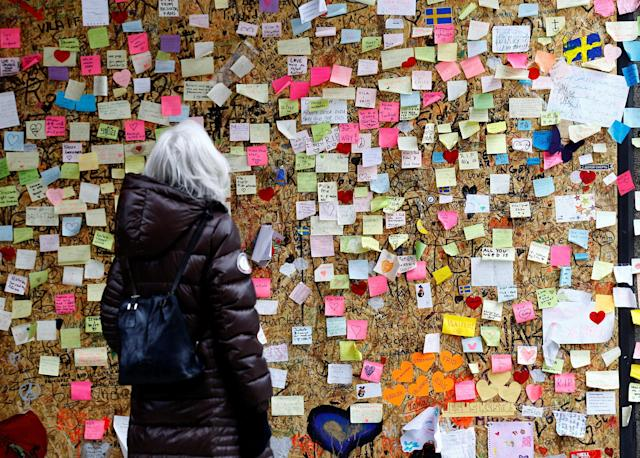 <p>A woman reads messages on a memorial wall near an area where a truck plunged into a crowd last month, at Ahlens department store along the pedestrian street of Drottninggatan in Stockholm, Sweden, May 8, 2017. (Ints Kalnins/Reuters) </p>